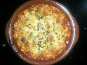 Tortellini de parmesano y carpaccio con salsa de tomate al horno